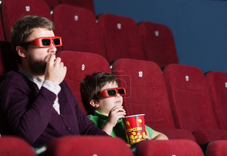 A boy with father at the cinema