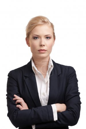 Business woman in a black suit, looking at the camera