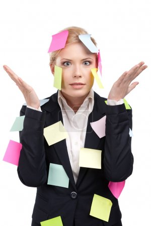 Young business woman with colored stickers on her face