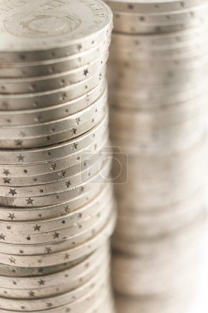 Silver coins stand vertically in two columns