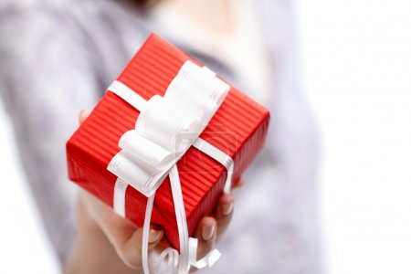 Showing present wrapped in red gift paper