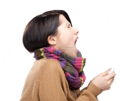 Sneezing young attractive woman holding wipe