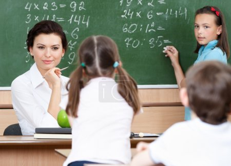 Teacher questions pupils at mathematics