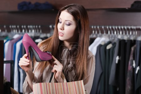Woman wonders at excellent shoes