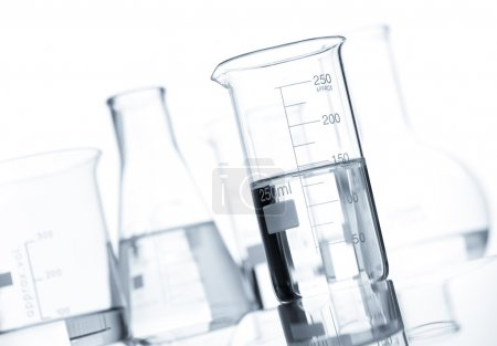 Set of classic laboratory flasks with a clear liquid