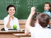 Teacher questions pupils at algebra