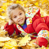 Child in autumn park.