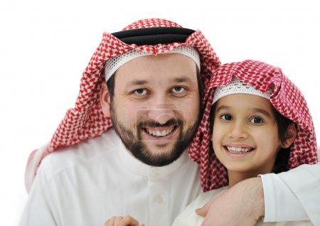 Arabian son and his father wearing keffiyeh