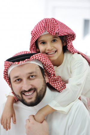 Adult and child with middle eastern clothes