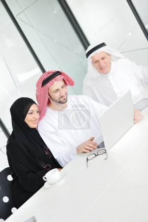 Successful and happy business arabic sitting for a meeting