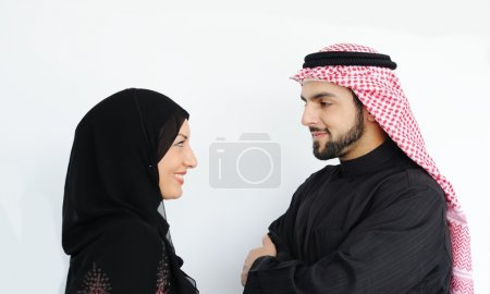 Two couple muslim standing and looking