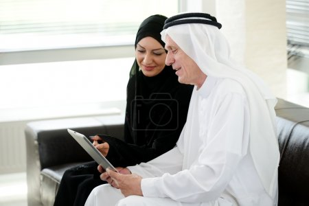 Two couple muslim on office with tablet