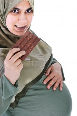 Pregnant muslim woman with chocolate