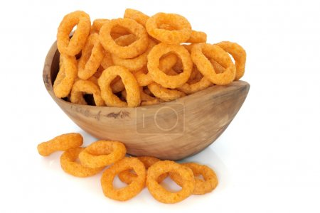 Photo for Onion ring crisps in an olive wood bowl and loose over white background. - Royalty Free Image