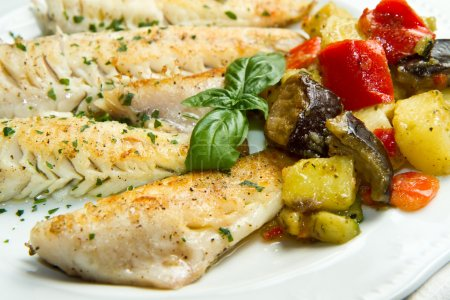 Photo for Tasty healthy fish fillet with vegetables - Royalty Free Image