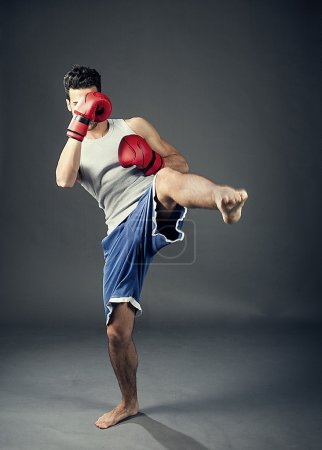 Photo for Photo of kick boxer hitting with his feet - Royalty Free Image