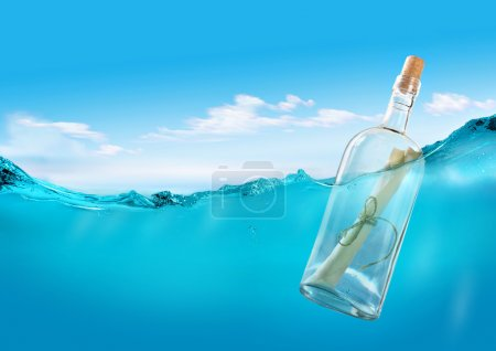 Photo for Bottle with a message in the ocean. - Royalty Free Image