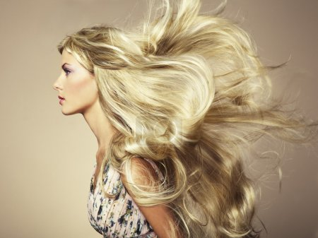 Photo for Photo of beautiful woman with magnificent hair. Fashion photo - Royalty Free Image