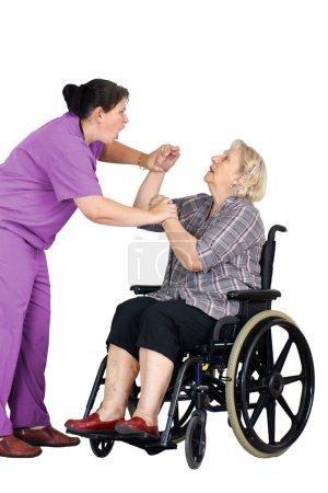 Nurse assaulting senior woman in wheelchair
