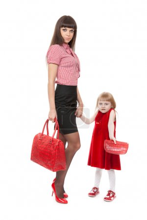 Fashionable Mom in red shoes and her little daughter with a beau