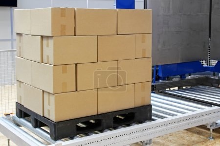 Photo for Cardboard boxes at transport pallet package - Royalty Free Image
