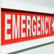 A red Emergency sign at the entrance to a hospital...