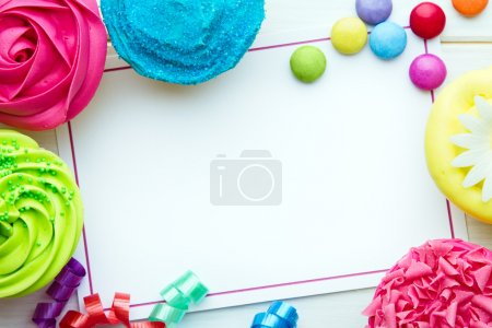 Photo for Party background with cupcakes and streamers - Royalty Free Image