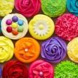Array of colorful cupcakes...
