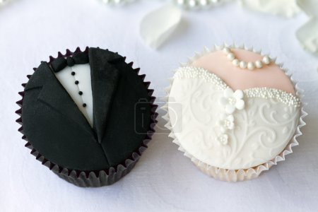 Bride and groom cupcakes...