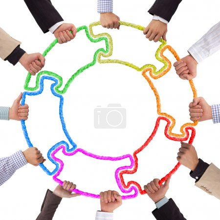 Photo for Hands holding puzzle forming circle - Royalty Free Image