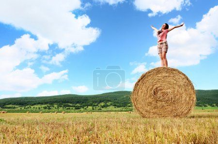 Photo for Woman enjoying on the wheat in field - Royalty Free Image