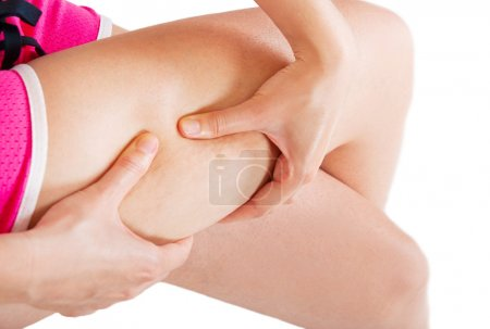 Young woman checking her cellulite