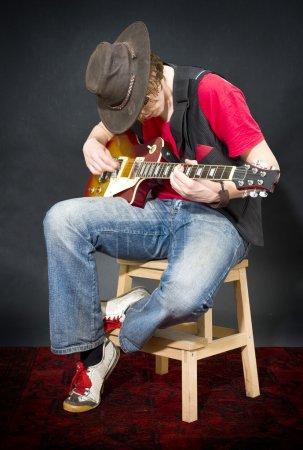 Sitting Guitar player