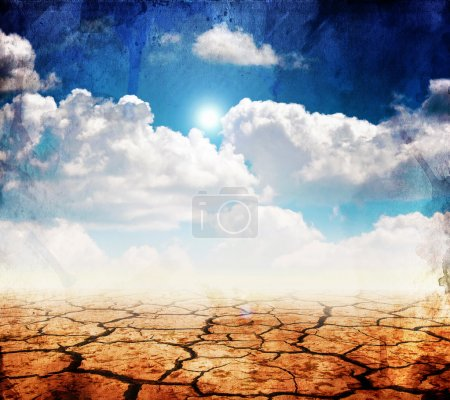 Photo for Dry desert land against a blue sky with clouds - Royalty Free Image