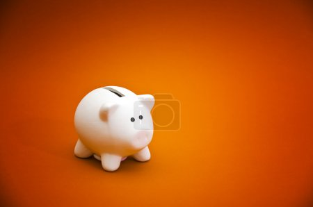 Photo for Beatiful white ceramic piggy coin bank, money savings concept - Royalty Free Image