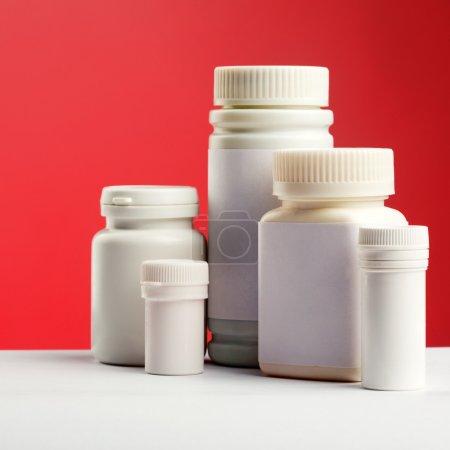 White pills bottles