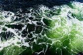Deep green ominous ocean water background