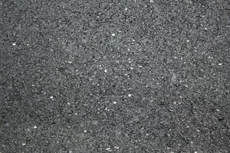 Photo pour Asphalte texture avec de petits morceaux de verre en regardant dans le miroir qu'il - image libre de droit