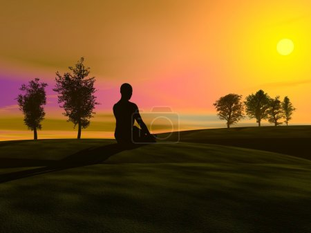 Photo for Shadow of a man meditating in the nature, on the grass next to trees by sunset - Royalty Free Image