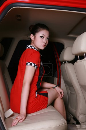 Photo for Beautiful woman with red car - Royalty Free Image