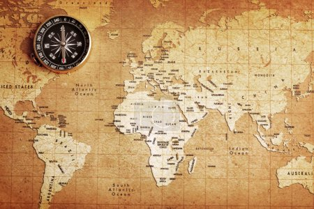Photo for An old brass compass on a Treasure map background - Royalty Free Image
