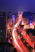 Traffic on night road junction