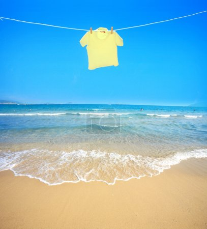 Photo for Clothes hanging on the clothesline,at the seaside - Royalty Free Image