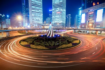 Photo for Shanghai downtown at night with roundabout light trails - Royalty Free Image