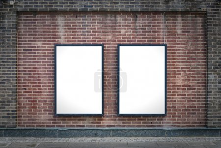 Photo for Two blank billboards attached to a buildings exterior brick wall. - Royalty Free Image