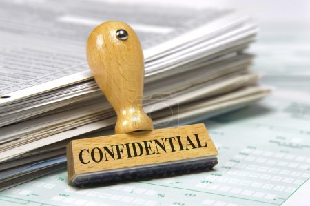 Rubber stamp on paper documents marked with confidential
