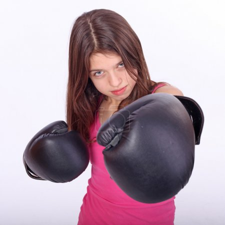 Beautiful young teen girl boxing