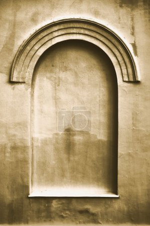 Old aged plastered faux arch false fake window stucco frame background