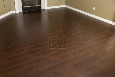 Photo for Beautiful Newly Installed Brown Laminate Flooring and Baseboards in Home. - Royalty Free Image