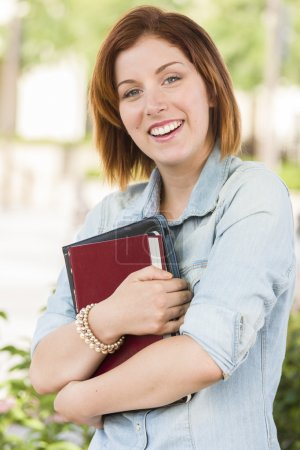 Photo for Smiling Young Pretty Female Student Standing Outside with Books. - Royalty Free Image
